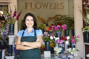 woman standing outside flower business